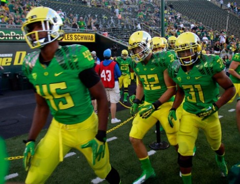 The Ducks' current home uniforms.